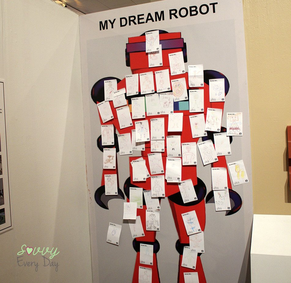 Kids drew their dream robot, then posted it on the wall to share.