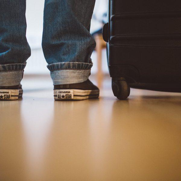 child next to their luggage