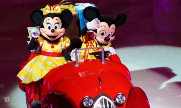 Mickey and Minnie Mouse waving hello from red car on the ice