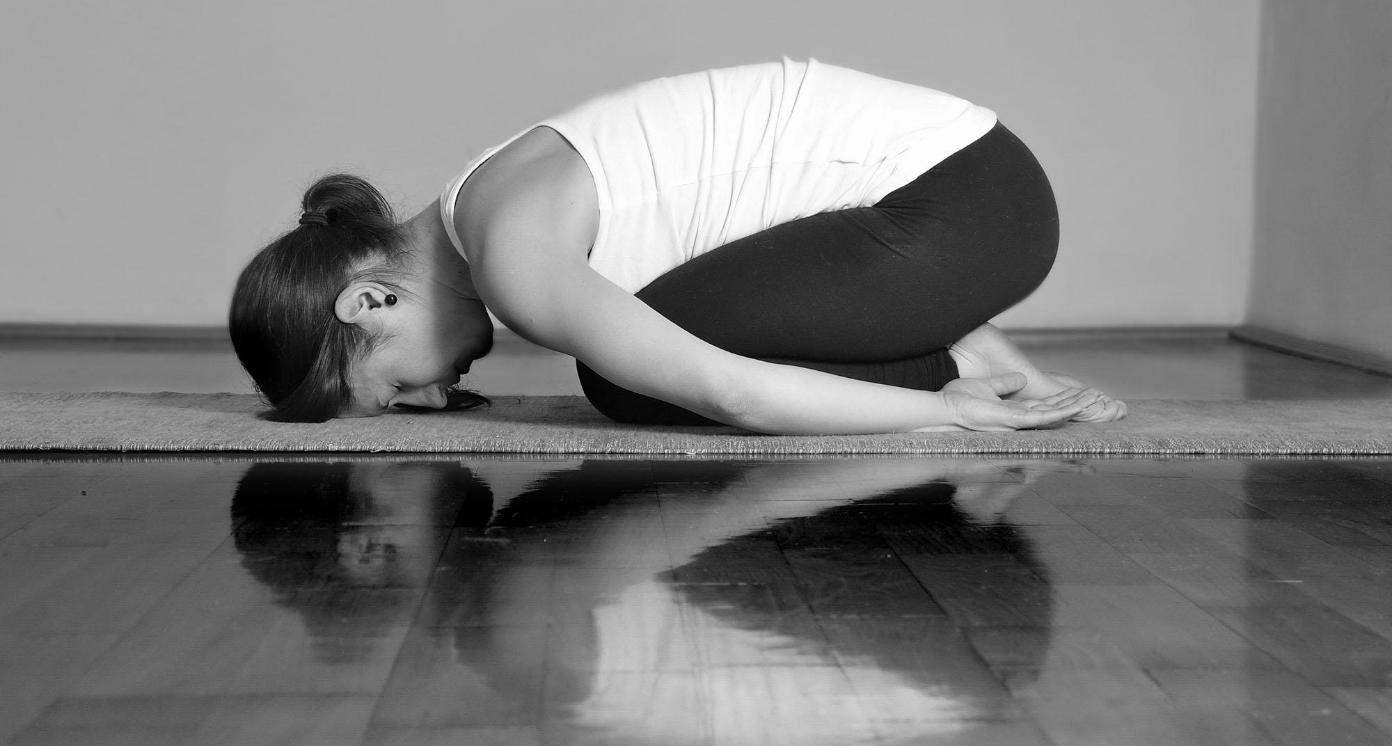 Girl doing Marichyasana A yoga pose