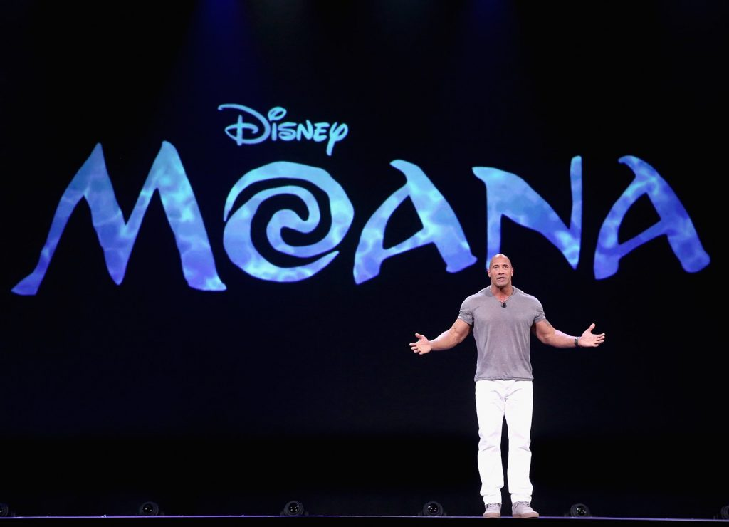 """Actor Dwayne Johnson talks about MOANA in """"Pixar and Walt Disney Animation Studios: The Upcoming Films"""" presentation at Disney's D23 EXPO 2015. Photo by Jesse Grant/Getty Images for Disney"""