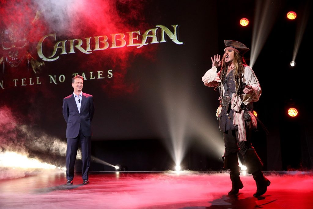 """ANAHEIM, CA - AUGUST 15: President of Walt Disney Studios Motion Picture Production Sean Bailey (L) and actor Johnny Depp, dressed as Captain Jack Sparrow, of PIRATES OF THE CARIBBEAN: DEAD MEN TELL NO TALES took part today in """"Worlds, Galaxies, and Universes: Live Action at The Walt Disney Studios"""" presentation at Disney's D23 EXPO 2015 in Anaheim, Calif. (Photo by Jesse Grant/Getty Images for Disney) *** Local Caption *** Johnny Depp; Sean Bailey"""