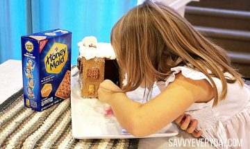 girl looking in a house made from Honey Maid Crackers