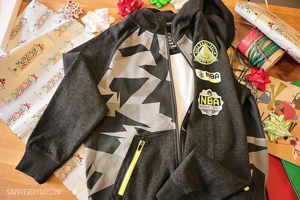 NBA Reflective Collection jacket set on top of gift wrap and bows