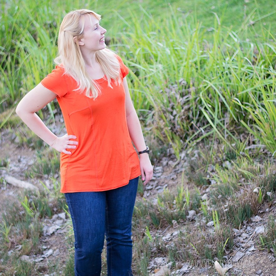 orange shirt looking up IG