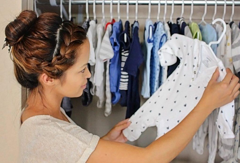 katrina looking at baby clothes