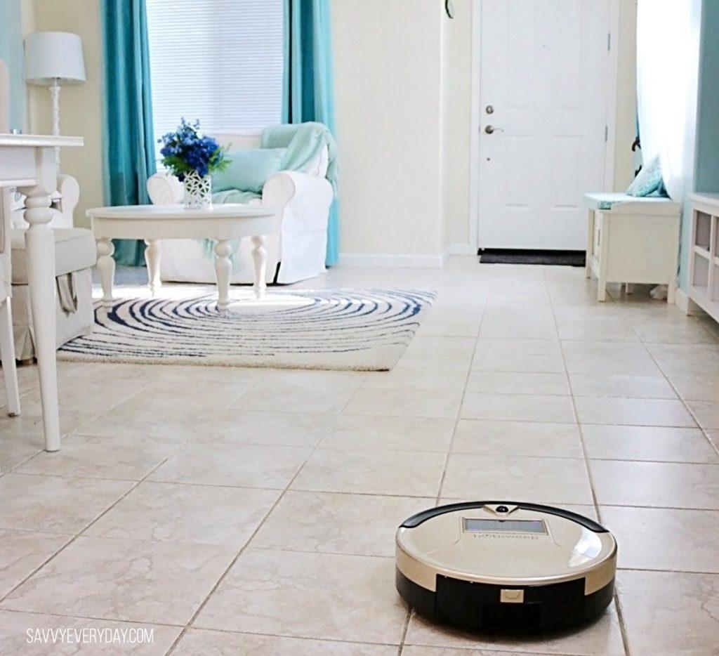 bObsweep cleaning livingroom