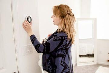 adjusting thermostat closeup