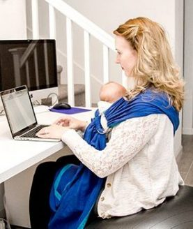 sitting on birthing ball at desk, researching things while babywearing