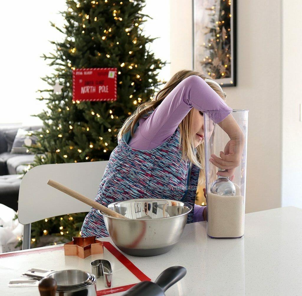little girl scooping sugar