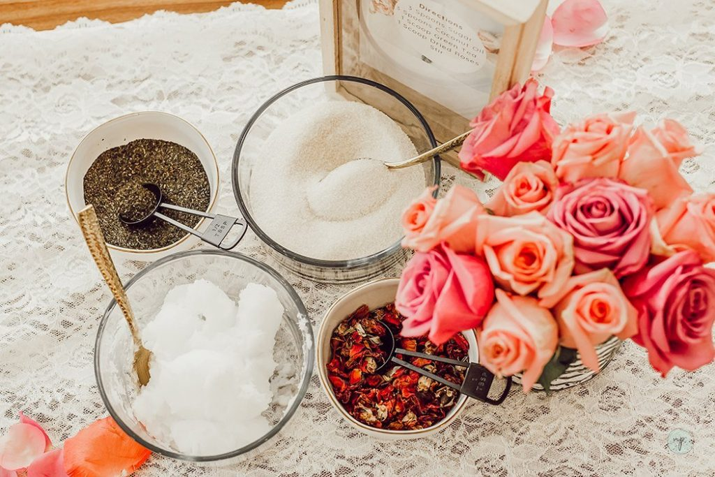 overhead shot of mixed green tea and rose sugar scrub ingredients