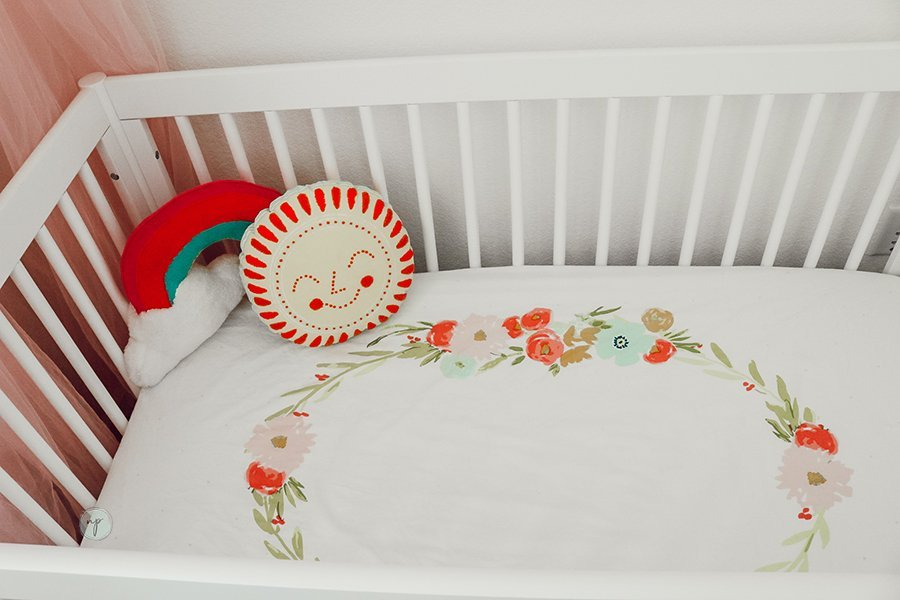 close up of floral bohemian crib