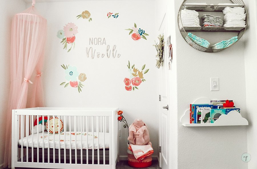 wide shot of floral bohemian nursery room