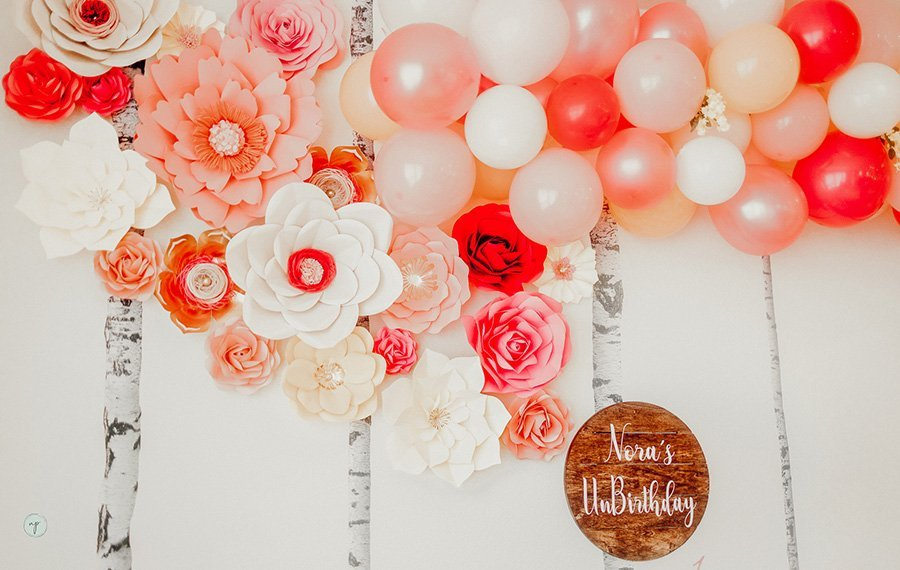Wonderland birthday wall flowers and balloons