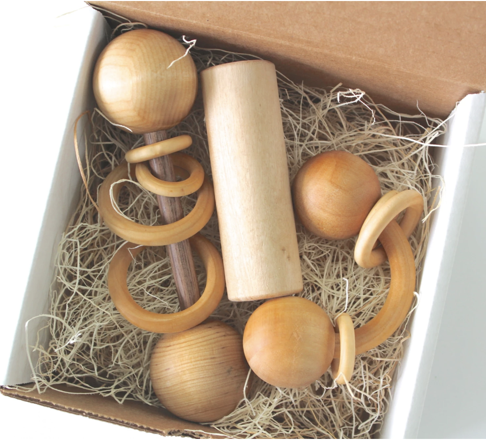 Box with wooden rattles in it