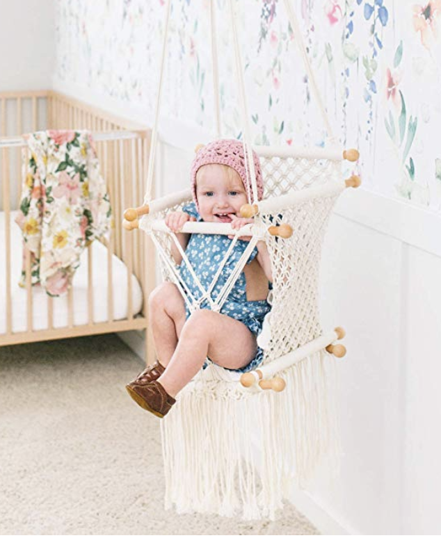 Baby sitting in macrame swing