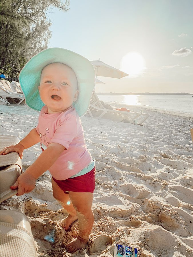 teething baby at the beach with orajel