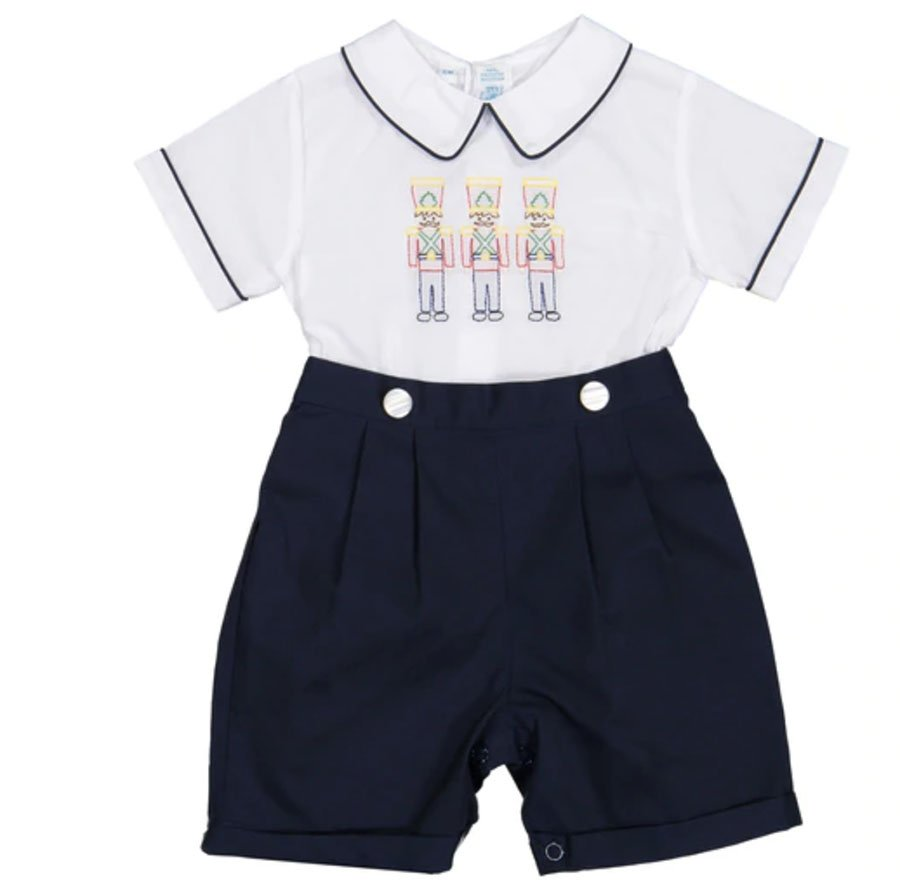 Boys' bobby suit in white and dark blue with three Nutcrackers embroidered on the front