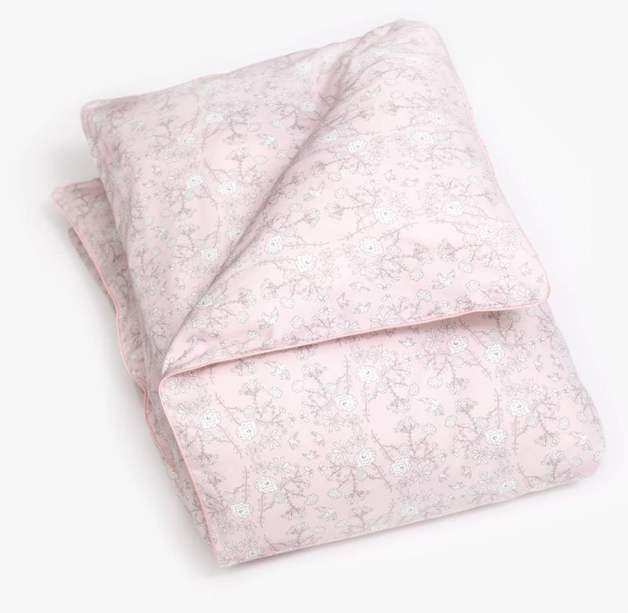 Pink Gooselings duvet cover with white floral pattern