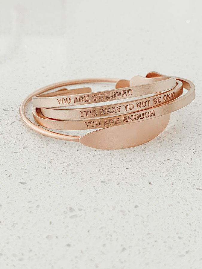 "Live Proverb engraved bracelets with different sayings on them like, "" You Are So Loved."""