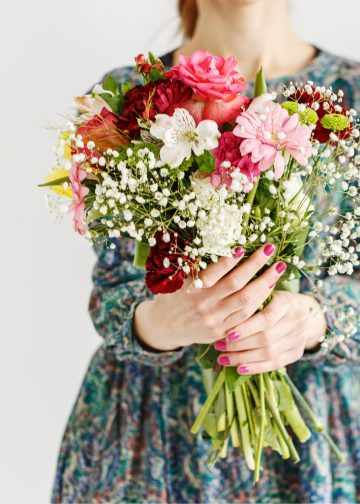Woman holding bouquet of mother's day flowers