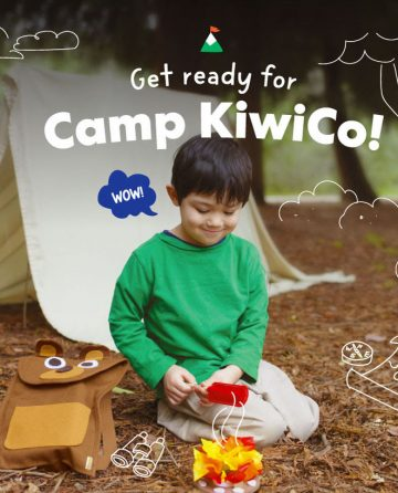 "Little boy smiles down at his DIY pretend campfire outside ""Get Ready for camp kiwico"""