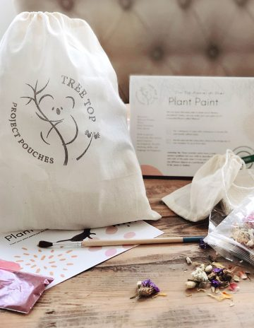 cotton bag sitting on table with dried flowers and recipe cards