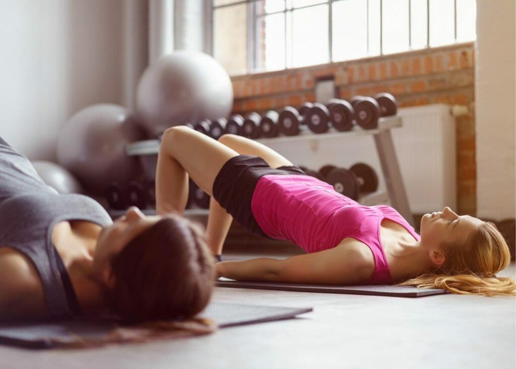 two women in pelvic yoga