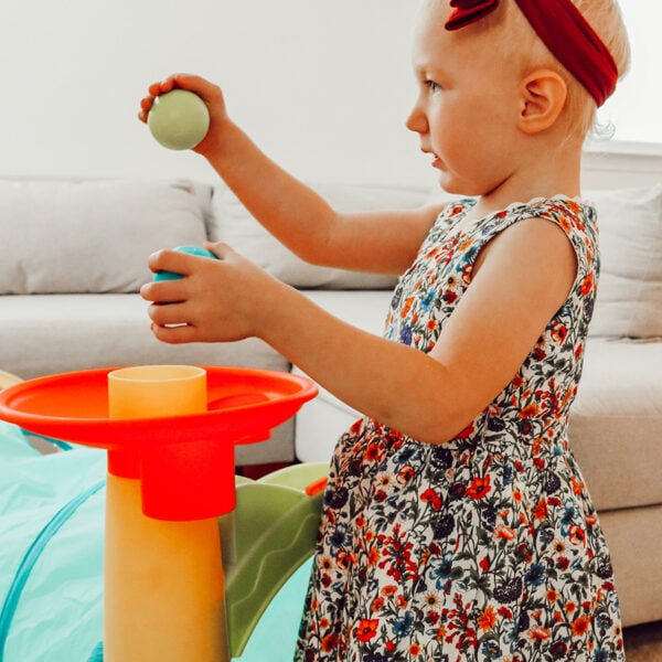 toddler looking at ball drop
